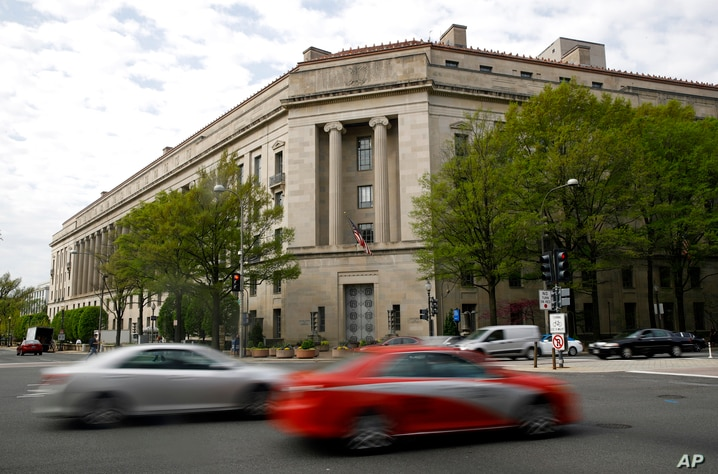 Traffic passes the Department of Justice building, Wednesday, April 17, 2019, in Washington. (AP Photo/Patrick Semansky)