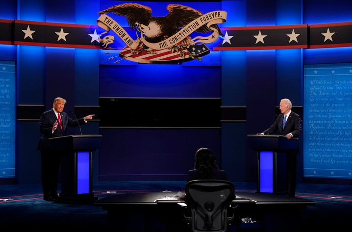 President Donald Trump, left, points towards Democratic presidential candidate former Vice President Joe Biden, right, during…