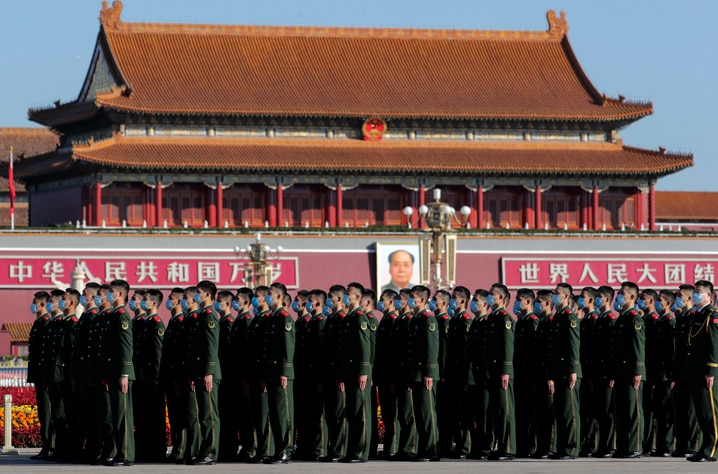 Chinese paramilitary policemen wearing face masks to help curb the spread of the coronavirus stand in formation on Tiananmen…
