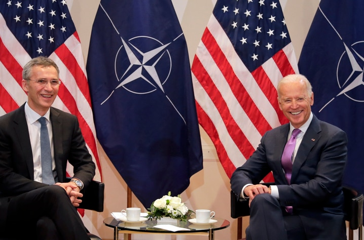 U.S. Vice President Joe Biden, right, and  NATO Secretary General Jens Stoltenberg pose for the media during a meeting at the…
