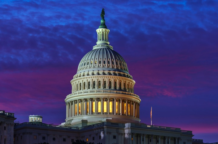 In shades of red and blue, dawn arrives on Capitol Hill in Washington, Friday, Nov. 6, 2020. (AP Photo/J. Scott Applewhite)