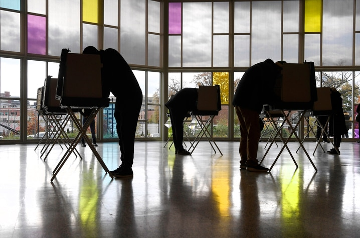 Voters mark their ballots at First Presbyterian Church on Election Day, Tuesday, Nov. 3, 2020, in Stamford, Conn. (AP Photo…