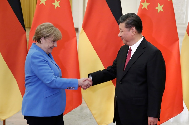 China's President Xi Jinping, right, meets German Chancellor Angela Merkel at the Great Hall of the People in Beijing, Thursday…