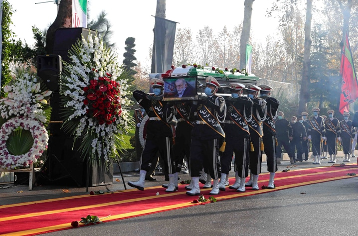 In this photo released by the official website of the Iranian Defense Ministry, military personnel carry the flag draped coffin…