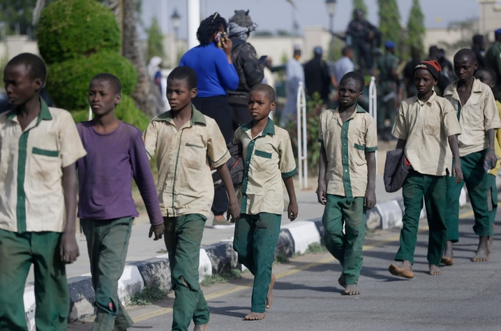 A group of schoolboys are escorted by Nigerian military and officials following their release after they were kidnapped last…