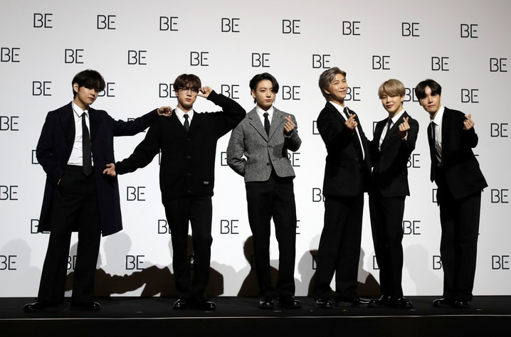 "Members of South Korean K-pop band BTS pose for photographers during a press conference to introduce their new album ""BE"" in…"