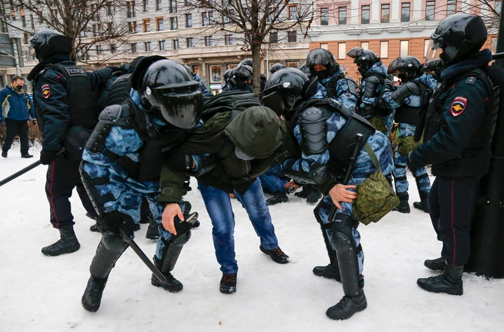Police detain a man during a protest against the jailing of opposition leader Alexei Navalny in Moscow, Russia, Saturday, Jan…