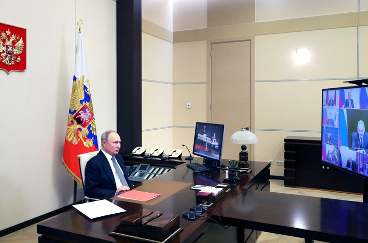 Russian President Vladimir Putin chairs a Security Council meeting via video conference at the Novo-Ogaryovo residence outside…