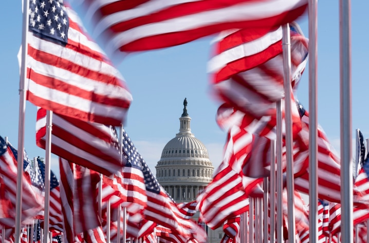 The U.S. Capitol is seen between flags placed on the National Mall ahead of the inauguration of President-elect Joe Biden and…