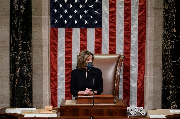 Speaker of the House Nancy Pelosi, D-Calif., leads the final vote of the impeachment of President Donald Trump, for his role in…