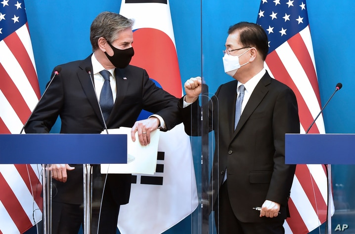 U.S. Secretary of State Antony Blinken, left, bumps elbows with South Korean Foreign Minister Chung Eui-yong after a joint…