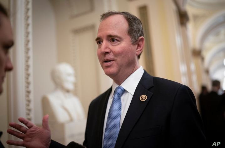 FILE - In this Tuesday, March 3, 2020, file photo, House Intelligence Committee Chairman Adam Schiff, D-Calif., talks to…