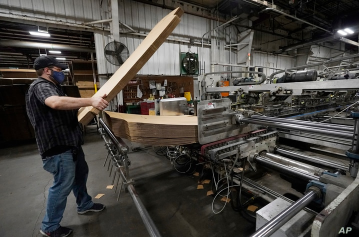 Rob Bondurant, a supervisor at Great Southern Industries, a packaging company, loads up a finishing machine in the Jackson,…