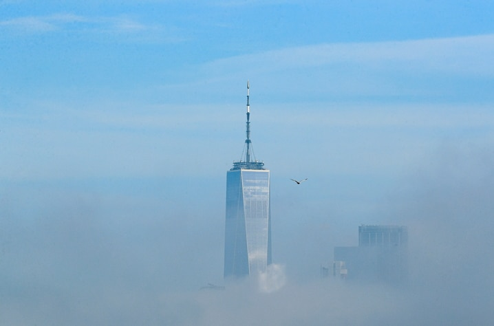 One World Trade Center building is seen through the fog in lower Manhattan in New York