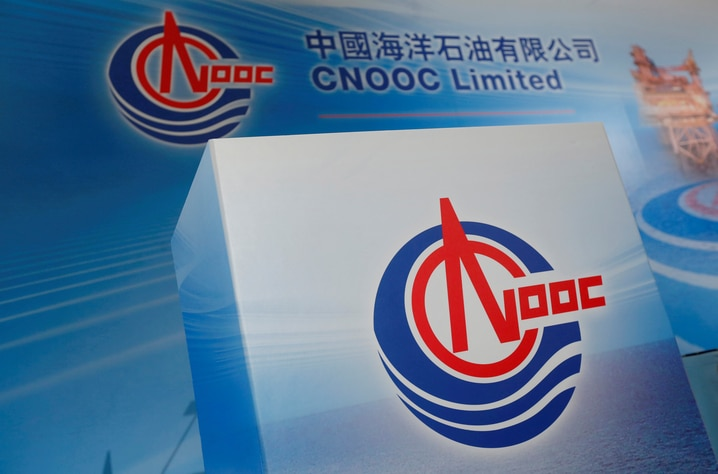 FILE PHOTO: Logos of China National Offshore Oil Corporation (CNOOC) are displayed at a news conference in Hong Kong