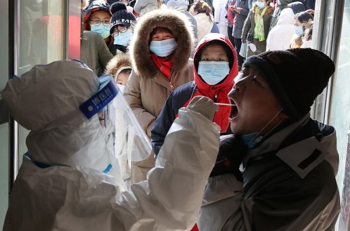 Medical worker collects a swab from a resident during a mass nucleic acid testing in Shijiazhuang