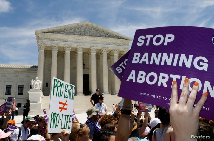FILE PHOTO: Abortion rights activists rally outside the U.S. Supreme Court in Washington