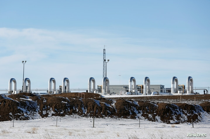 FILE PHOTO: A TC Energy pump station sits behind mounds of dirt from the Keystone XL crude oil pipeline as it lies idle near Oyen