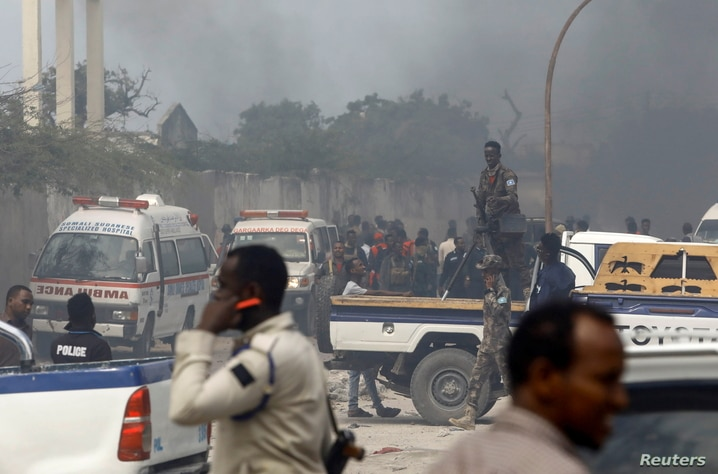 A general view shows security officers and rescuers at the scene of a car explosion near Banadir hospital in Mogadishu