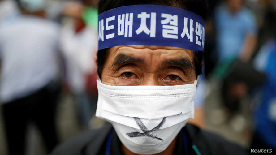 FILE - A Seoungju resident takes part in a protest against the government's decision on deploying a U.S. THAAD anti-missile defense unit in Seongju, in Seoul, South Korea, July 21, 2016.
