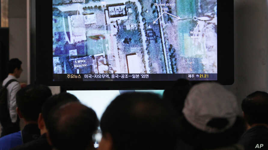 FILE - South Koreans watch a television broadcasting a satellite image of the nuclear facility in North Korea, at the Seoul Railway Station in Seoul, South Korea, Oct. 8, 2013.