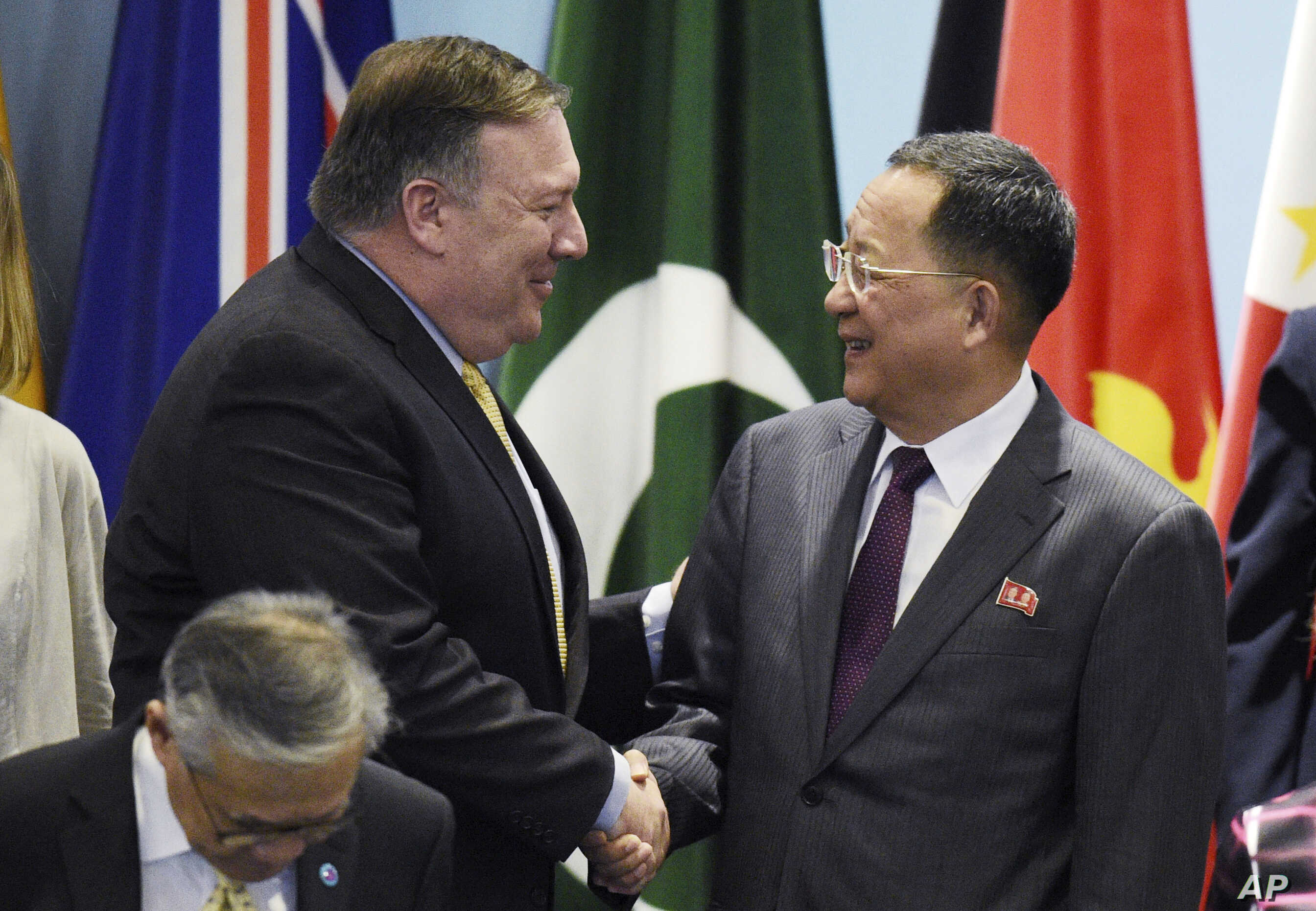 FILE - U.S. Secretary of State Mike Pompeo, left, greets North Korea's Foreign Minister Ri Yong Ho at the 25th ASEAN Regional Forum Retreat in Singapore, Aug. 4, 2018. President Donald Trump on Aug. 24 called off a visit to North Korea by Pompeo  becau...