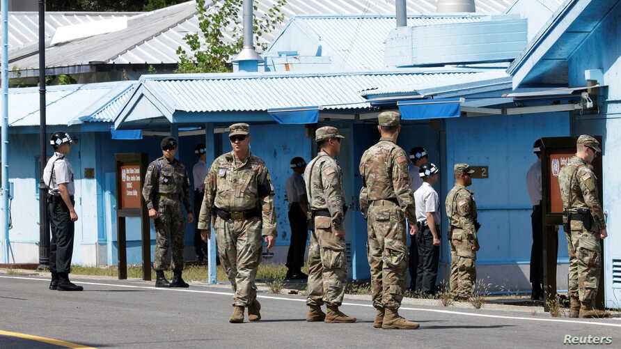 South Korean and U.S. Army soldiers stand guard at the border village of Panmunjom in the Demilitarized Zone, South Korea, Sept. 7, 2018.
