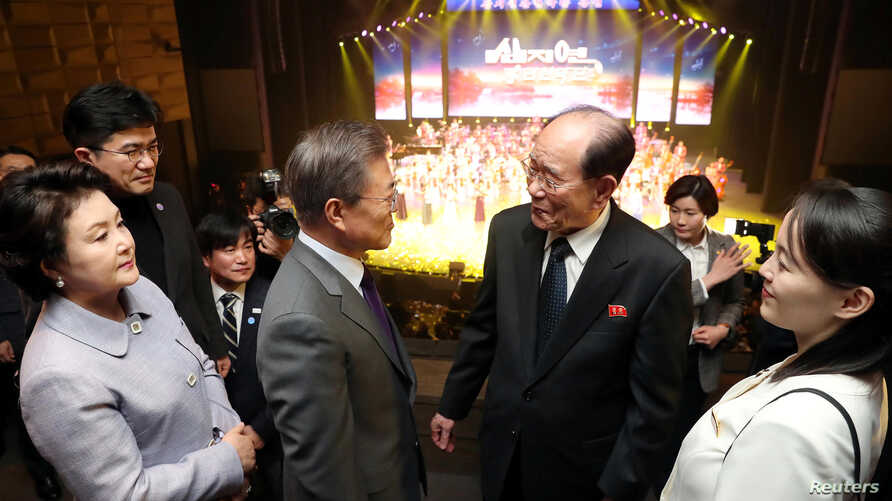South Korean President Moon Jae-in talks with president of the Presidium of the Supreme People's Assembly of North Korea Kim Young Nam as Kim Yo Jong, the sister of North Korea's leader Kim Jong Un, looks on after North Korea's Samjiyon Orchestra's per...