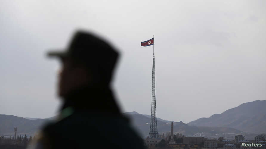 FILE - A North Korean flag flutters on top of a tower at the propaganda village of Gijungdong in North Korea, in this picture taken near the truce village of Panmunjom. New reviews of satellite images suggest Pyongyang may possess another missile launc...
