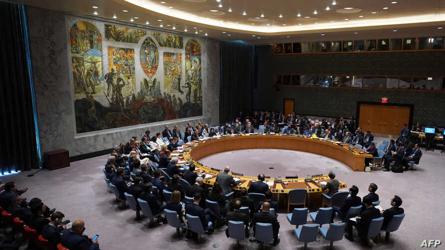 FILE - Members of the U.N. Security Council gather for a meeting on North Korea, Sept. 27, 2018, at the United Nations in New York.
