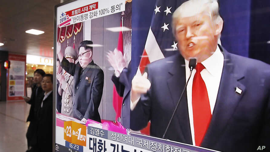 FILE - A TV screen shows pictures of then-U.S. President-elect Donald Trump, right, and North Korean leader Kim Jong Un, at the Seoul Railway Station in Seoul, South Korea, Nov. 10, 2016.