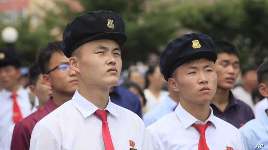 FILE - People watch a news broadcast on a missile launch in Pyongyang, North Korea, July 29, 2017. North Korean leader Kim Jong Un said the second flight test of an intercontinental ballistic missile demonstrated his country could hit the U.S. mainland.