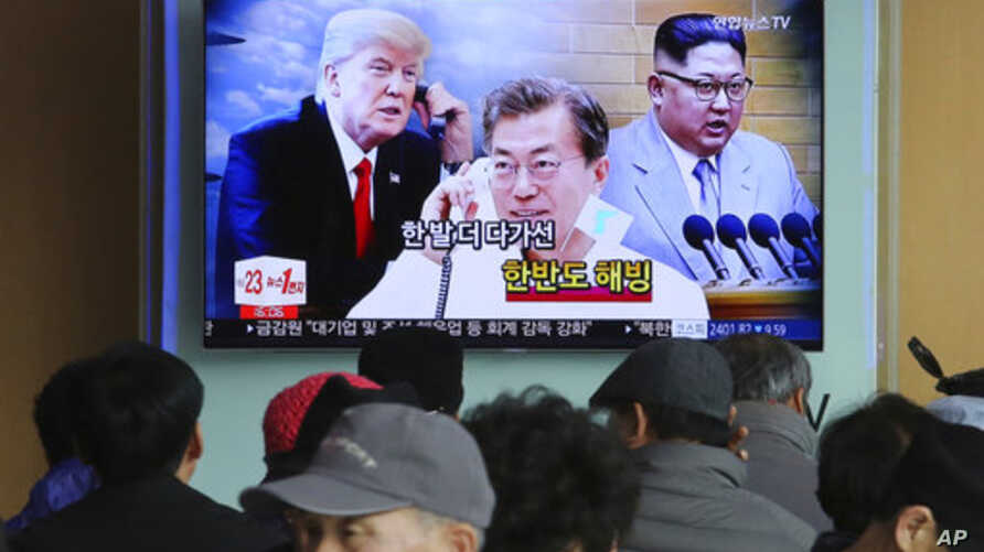 FILE - People watch a TV screen showing images of North Korean leader Kim Jong Un, right, South Korean President Moon Jae-in, center, and U.S. President Donald Trump at the Seoul Railway Station in Seoul, South Korea, March 7, 2018.