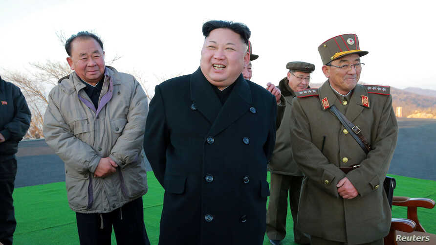 North Korean leader Kim Jong Un supervised a ballistic rocket launching drill of Hwasong artillery units of the Strategic Force of the KPA on the spot in this undated photo released by North Korea's Korean Central News Agency (KCNA) in Pyongyang March ...
