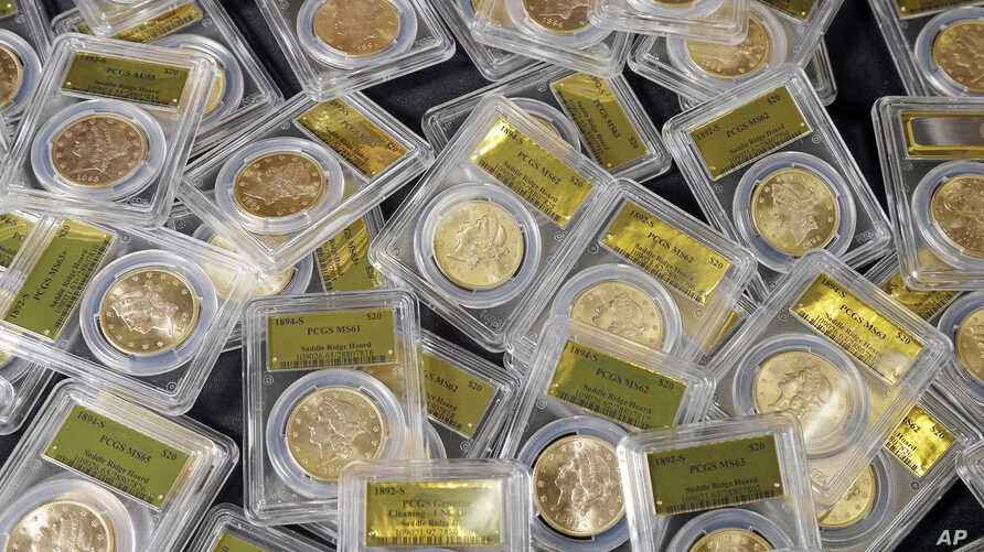 Some of 1,427 Gold-Rush era U.S. gold coins are displayed at Professional Coin Grading Service in Santa Ana, Calif., Tuesday, Feb. 25, 2014.