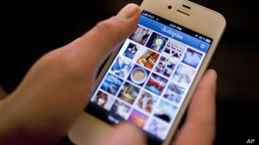 Instagram is demonstrated on an iPhone, in New York. (AP Photo/Karly Domb Sadof, File)