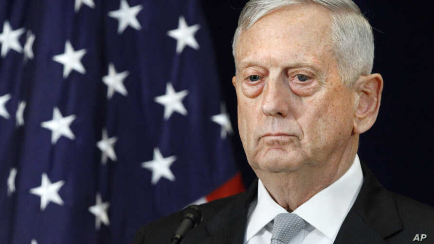 FILE - Defense Secretary James Mattis attends a news conference.