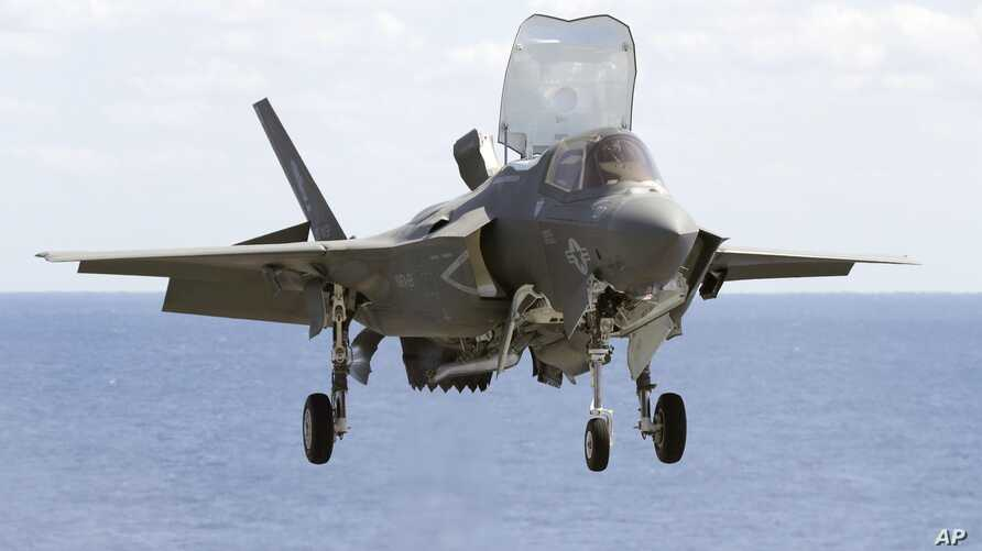 In this March 23, 2018, photo, U.S. military F-35B fighter jet lands aboard amphibious assault ship Wasp during an exercise in the western Pacific. (Takuto Kaneko/Kyodo News via AP)
