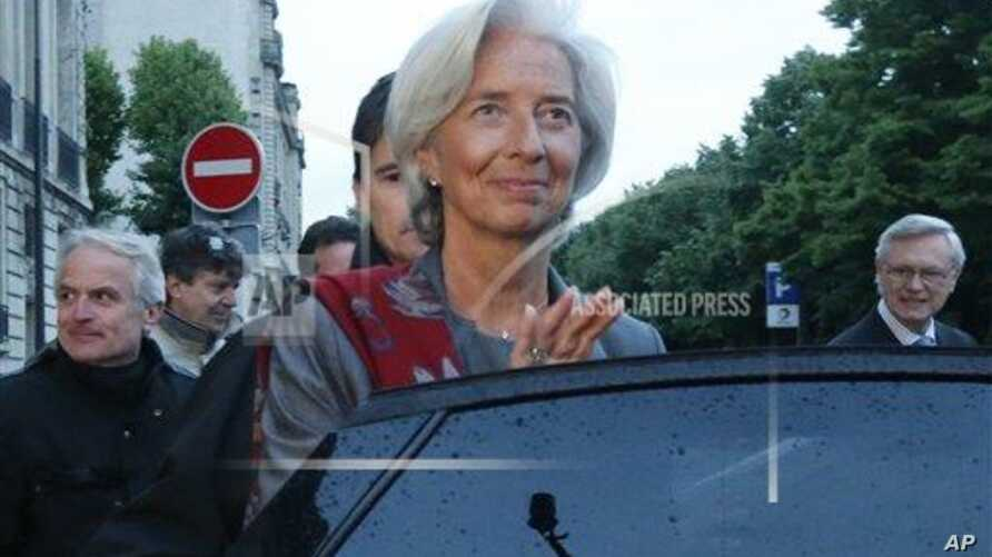 Head of the International Monetary Fund, Christine Lagarde, leaves a special court house Paris, Friday, May 24, 2013. IMF chief Christine Lagarde says a Paris court has named her as a key witness in an investigation into a controversial payoff to an outsp