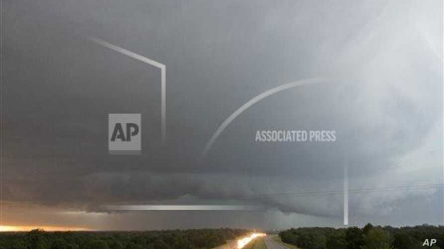 A tornado forms over I-40 as seen looking west from Indian Meridian Road in Midwest City, Okla. on Friday, May 31, 2013. (AP Photo/Alonzo Adams)