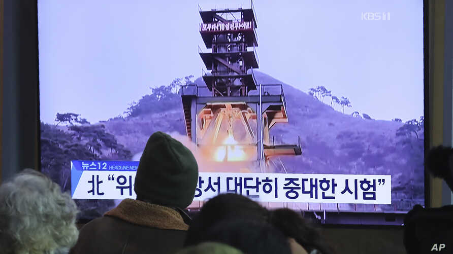 """People watch a TV screen showing a file image of a ground test of North Korea's rocket engine during a news program at the Seoul Railway Station in Seoul, South Korea, Monday, Dec. 9, 2019. North Korea said Sunday it carried out a """"very important…"""