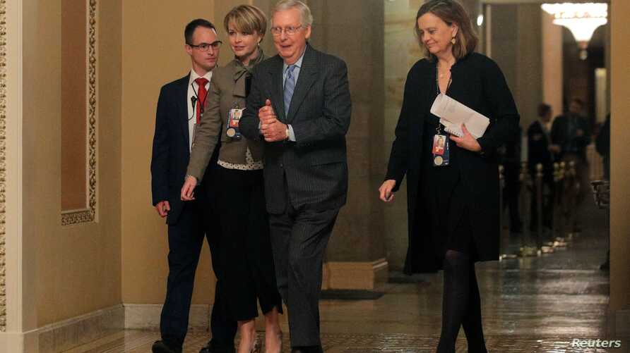U.S. Senate Majority Leader Mitch McConnell (R-KY) walks during a break in the Senate impeachment trial of U.S. President…