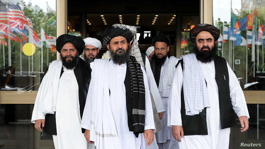 FILE PHOTO: Members of a Taliban delegation leaving after peace talks with Afghan senior politicians in Moscow, Russia May 30,…