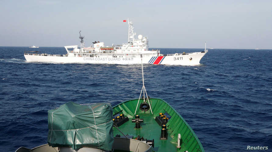 A ship (top) of the Chinese Coast Guard is seen near a ship of the Vietnam Marine Guard in the South China Sea, about 210 km …