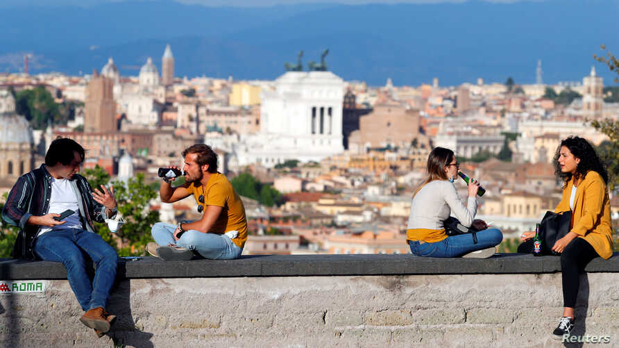 People enjoy drinks at the Gianicolo hill, amid the coronavirus disease (COVID-19) outbreak, in Rome, Italy, May 8, 2020…