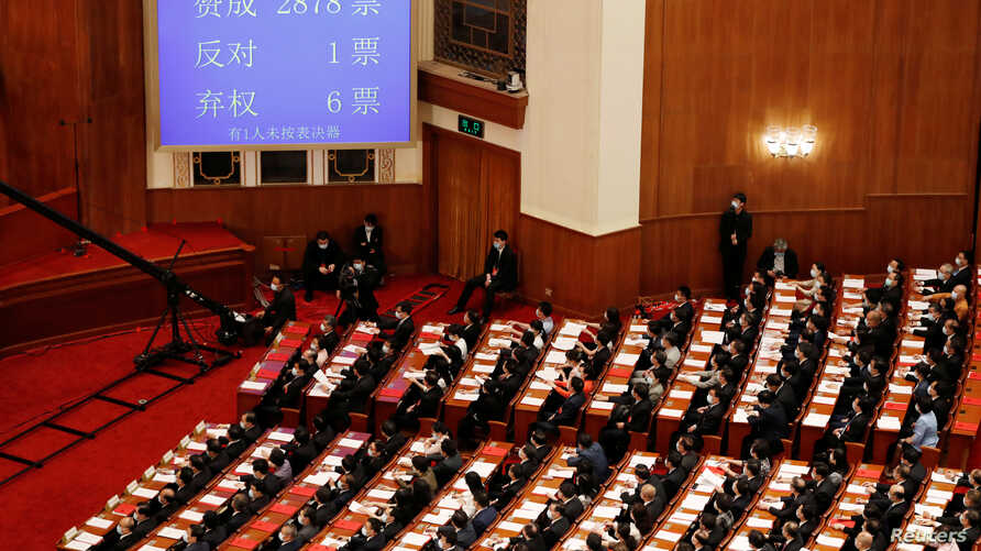 A screen shows the results of the vote on the national security legislation for Hong Kong Special Administrative Region at the…