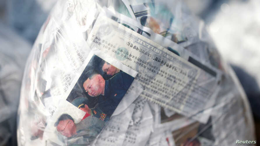 A leaflet denouncing North Korean leader Kim Jong Un and a one-dollar banknote are seen inside a balloon, near the…