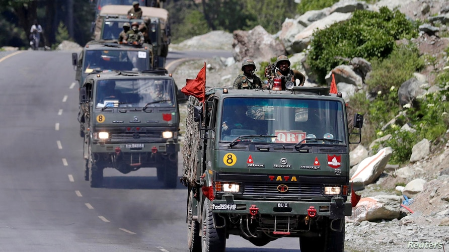 FILE PHOTO: An Indian Army convoy moves along a highway leading to Ladakh, at Gagangeer in Kashmir's Ganderbal district June 18…