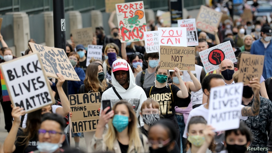 Demonstrators attend a Black Lives Matter protest following the death of George Floyd in Minneapolis police custody, in London,…