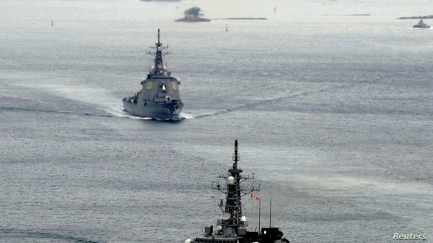 Japan Maritime Self-Defense Force's (JMSDF) Aegis destroyers Myoko (front) and Kongo sail off from the JMSDF Sasebo base in…
